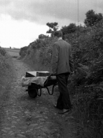 Collector Leo Corduff transporting heavy recording equipment along a country lane near Scotstown, Co. Monaghan in 1965.