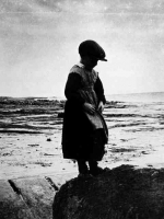 Boy in petticoat, Inis Meain, Co. Galway, 1930. It is thought that young boys were sometimes dressed in skirts to protect them from fairy abduction. A belief existed that the fairies would choose boys before girls.