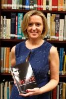 Liz Nugent holding the French translation of Unravelling Oliver