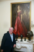 Michael Smith with the portrait of Princess Grace in the background